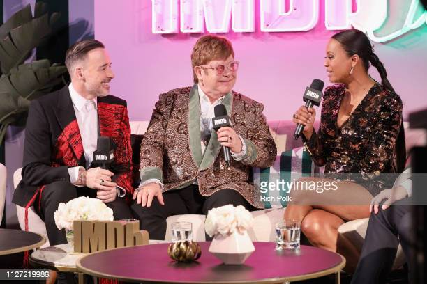 David Furnish Sir Elton John and host Aisha Tyler attend IMDb LIVE at the Elton John AIDS Foundation Academy Awards® Viewing Party on February 24...