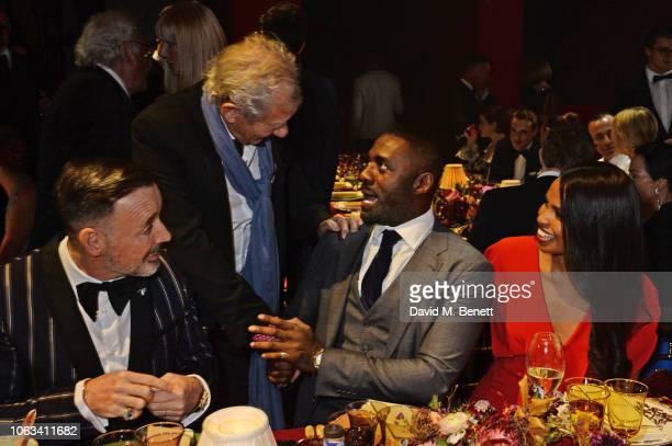 David Furnish Sir Ian McKellen Idris Elba and Sabrina Dhowre attend The 64th Evening Standard Theatre Awards at the Theatre Royal Drury Lane on...