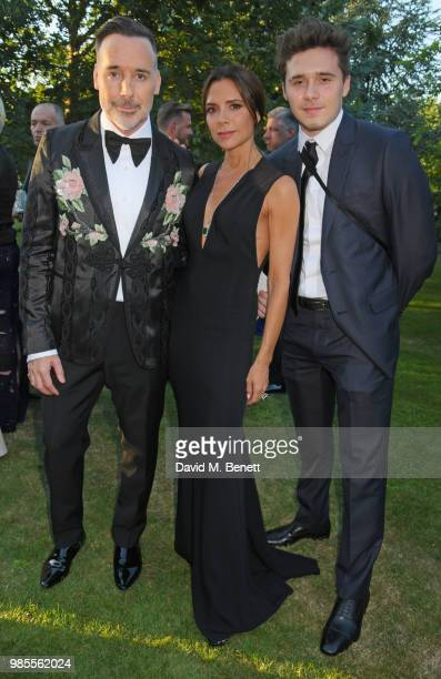 David Furnish Victoria Beckham and Brooklyn Beckham attend the Argento Ball for the Elton John AIDS Foundation in association with BVLGARI Bob and...