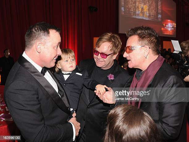 David Furnish, Zachary Furnish-John, Sir Elton John and Bono attend the 21st Annual Elton John AIDS Foundation Academy Awards Viewing Party at West...