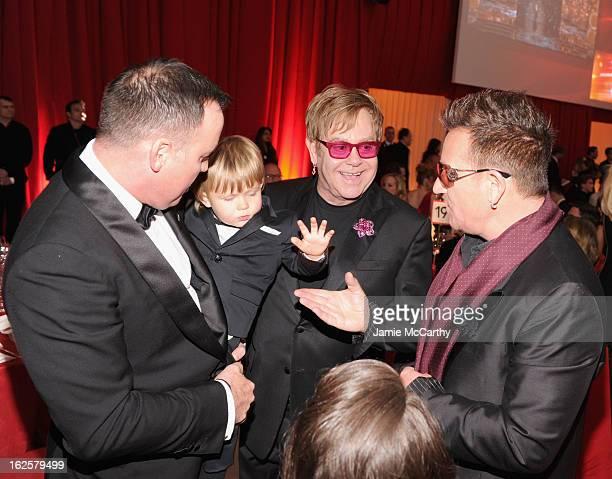 David Furnish, Zachary Furnish-John, Sir Elton John and singer Bono of U2 attend the 21st Annual Elton John AIDS Foundation Academy Awards Viewing...