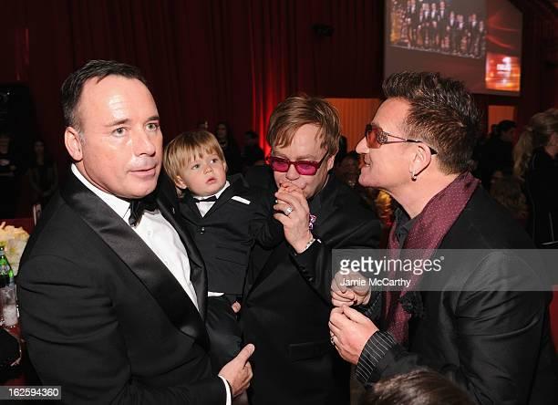 David Furnish, Zachary Furnish-John, Sir Elton John and singer Bono attend the 21st Annual Elton John AIDS Foundation Academy Awards Viewing Party at...