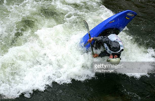David Fusilli of Strattonville, Pennsylvania competes in the Men's Kayak Pro Freestyle Qualifier in Whitewater Park on Gore Creek during The Teva...