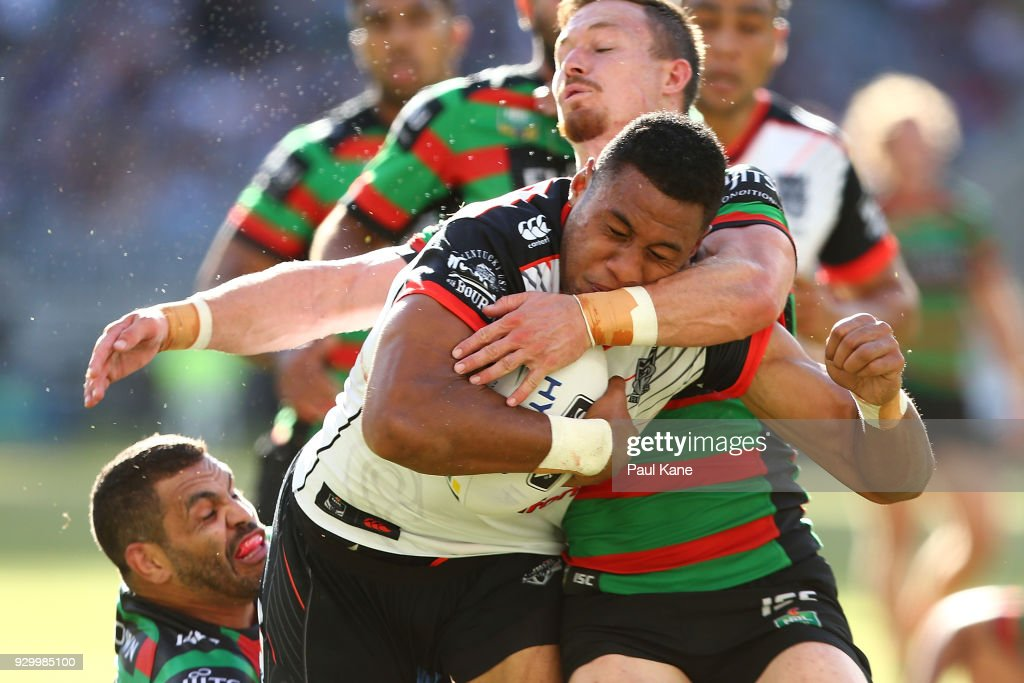 David Fusitu'a of the Warriors breaks a tackle by Greg Inglis and Damien Cook of the Rabbitohs to cross for a try during the round one NRL match between the South Sydney Rabbitohs and the New Zealand Warriors at Optus Stadium on March 10, 2018 in Perth, Australia.