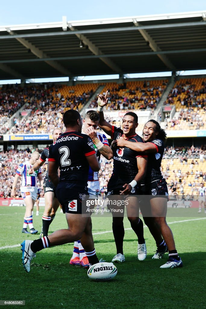 David Fusitu'a of the Warriors celebrates with teammates after scoring a try during the round one NRL match between the New Zealand Warriors and the Newcastle Knights at Mt Smart Stadium on March 5, 2017 in Auckland, New Zealand.