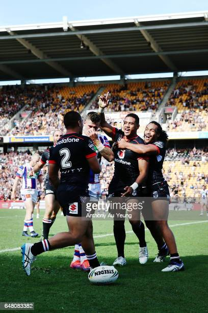 David Fusitu'a of the Warriors celebrates with teammates after scoring a try during the round one NRL match between the New Zealand Warriors and the...
