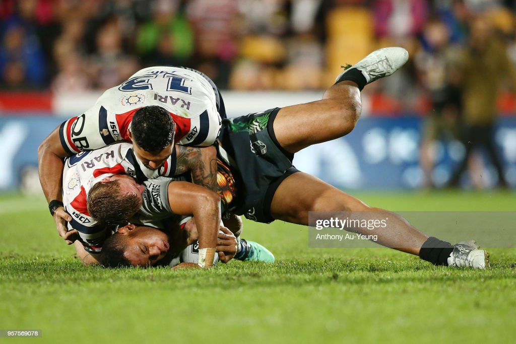 David Fusitu'a of the Warriors is tackled Jake Friend and Isaac Liu of the Roosters during the round 10 NRL match between the New Zealand Warriors and the Sydney Roosters at Mt Smart Stadium on May 12, 2018 in Auckland, New Zealand.
