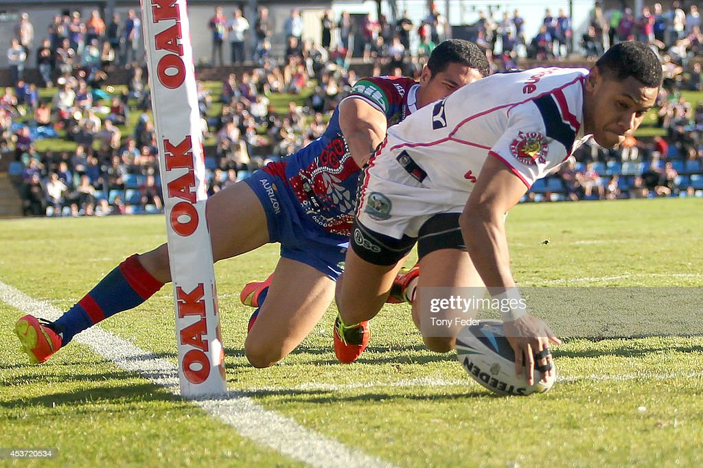 David Fusitu'a of the Warriors scores a try during the round 23 NRL match between the Newcastle Knights and the New Zealand Warriors at Hunter Stadium on August 17, 2014 in Newcastle, Australia.