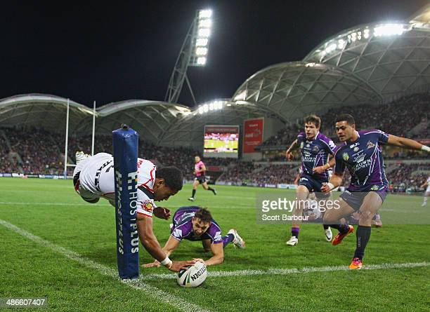 David Fusitua of the Warriors scores the first try of the match during the round 8 NRL match between the Melbourne Storm and the New Zealand Warriors...