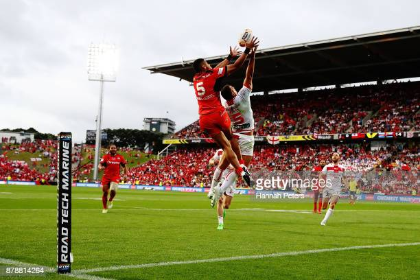 David Fusitua of Tonga competes with Ryan Hall of England for the ball during the 2017 Rugby League World Cup Semi Final match between Tonga and...