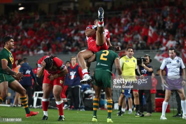 David Fusitu'a of Tonga falls onto Josh Addo-Carr of Australia during the Rugby League International Test match between the Australia Kangaroos and...