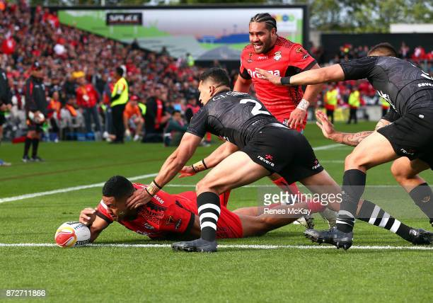 David Fusitua of Tonga scores a for Tonga during the 2017 Rugby League World Cup match between the New Zealand Kiwis and Tonga at Waikato Stadium on...
