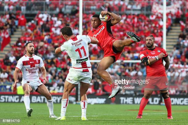 David Fusitua of Tonga takes the high ball from Samuel Burgess of England during the 2017 Rugby League World Cup Semi Final match between Tonga and...