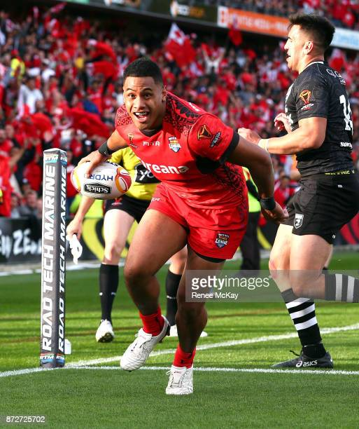 David Fusitua scores a try for Tonga during the 2017 Rugby League World Cup match between the New Zealand Kiwis and Tonga at Waikato Stadium on...