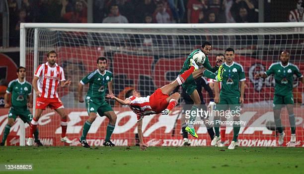 David Fuster of Olympiacos shoots as Zeca of Panthinaikos defends during the Super League match between Olympiacos Piraeus and Panathinaikos FC at...