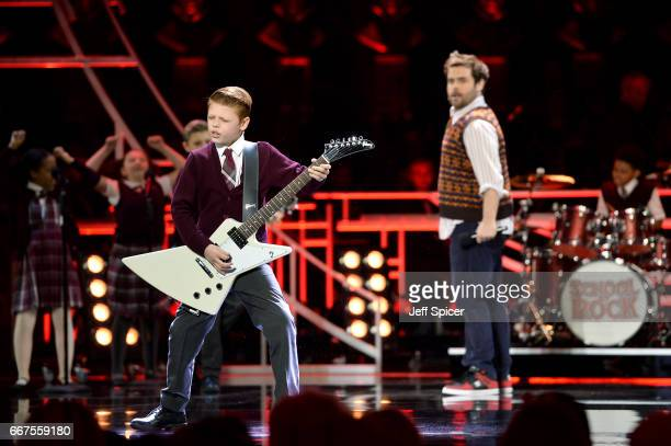David Fynn and the cast perform an excerpt from School of Rock on stage during The Olivier Awards 2017 at Royal Albert Hall on April 9 2017 in London...