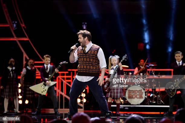 David Fynn performs an excerpt from School of Rock on stage during The Olivier Awards 2017 at Royal Albert Hall on April 9 2017 in London England