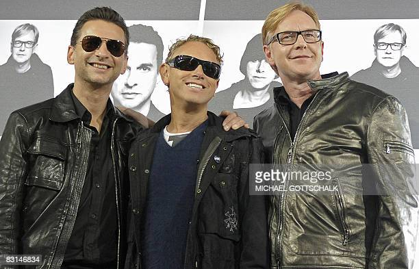 David Gahan Martin Gore and Andrew Fletcher of British group Depeche Mode pose on October 6 2008 at the Olympic stadium in Berlin during a photocall...