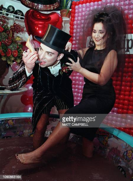 David Gakshteyn drinks melted chocolate from the shoe of his new wife Cleo Londono after the two were married on Valentines Day while standing in a...