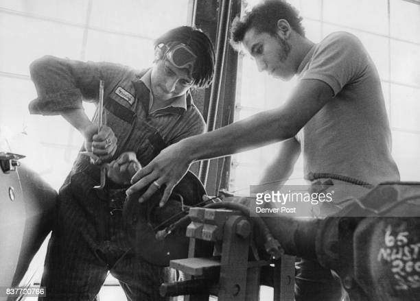 David Gallegos of 3228 Clay St left and Isaias Garcia of 324 E 52nd Ave both students at the center work on a car's rear axle assembly Credit Denver...