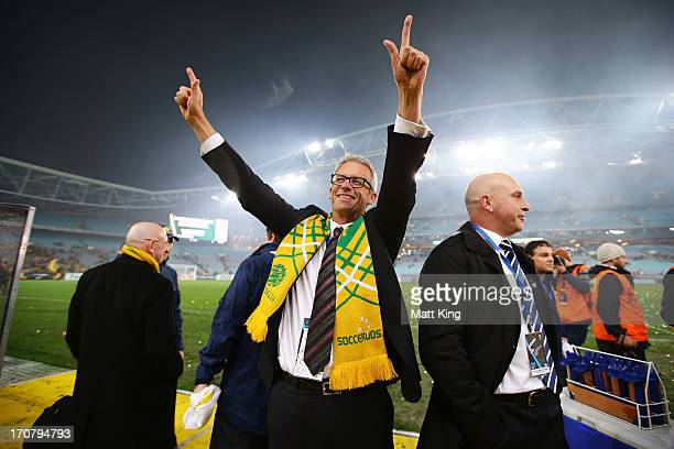 David Gallop celebrates and waves to fans after the Socceroos victory during the FIFA 2014 World Cup Asian Qualifier match between the Australian...