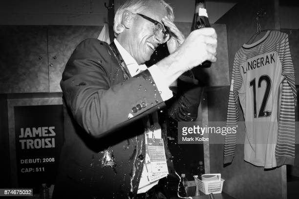 David Gallop is sprayed with beers as Australia celebrate victory in the change rooms after winning the 2018 FIFA World Cup Qualifiers Leg 2 match...
