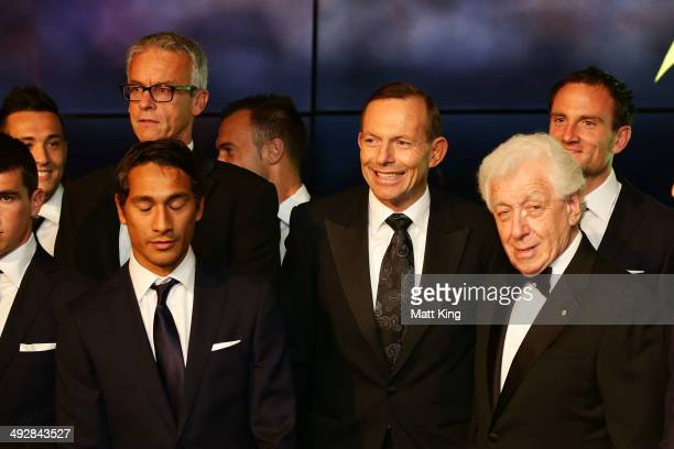 FFA CEO David Gallop Prime Minister of Australia Tony Abbott and FFA Chairman Frank Lowy pose with the Australian Socceroos during the Australian...