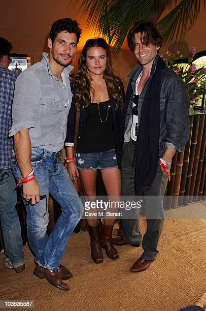 David Gandy Amanda Charlwood and Louis Dowler pose for a photograph in the official VIP backstage area hosted by Mahiki during Day one of V Festival...