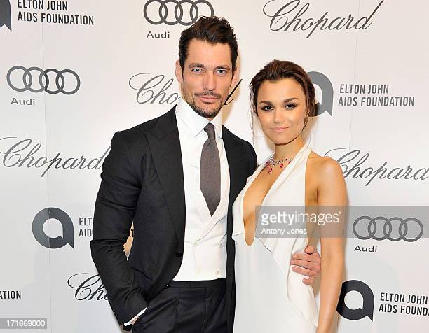 David Gandy (L) and Samantha Barks attend the 15th Annual White Tie and Tiara Ball to Benefit Elton John AIDS Foundation in Association with Chopard at Woodside on June 27, 2013 in Windsor, England. No sales to online/digital media worldwide until the 14th of July. No sales before July 14th, 2013 in UK, Spain, Switzerland, Mexico, Dubai, Russia, Serbia, Bulgaria, Turkey, Argentina, Chile, Peru, Ecuador, Colombia, Venezuela, Puerto Rico, Dominican Republic, Greece, Canada, Thailand, Indonesia, Morocco, Malaysia, India, Pakistan, Nigeria. All pictures are for editorial use only and mention of 'Chopard' and 'The Elton John Aids Foundation' are compulsory. No sales ever to Ok, Now, Closer, Reveal, Heat, Look or Grazia magazines in the United Kingdom. No sales ever to any jewellers or watchmakers other than Chopard
