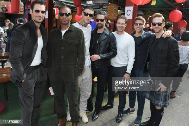 David Gandy, Eric Underwood, guest, Jack Guinness, Paul Sculfor, Johannes Huebl and Craig McGinlay attend the Oliver Spencer Menswear SS20 show...