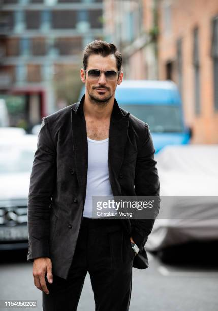 David Gandy is seen wearing brown suit outside Belstaff during London Fashion Week Men's June 2019 on June 09, 2019 in London, England.