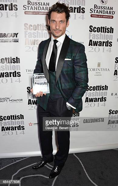 David Gandy poses after winning the Founders Award during the Scottish fashion invasion of London at the 9th annual Scottish Fashion Awards at 8...