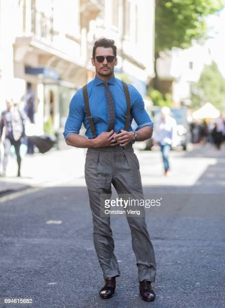 David Gandy wearing a blue button shirt tie suspenders during the London Fashion Week Men's June 2017 collections on June 10 2017 in London England