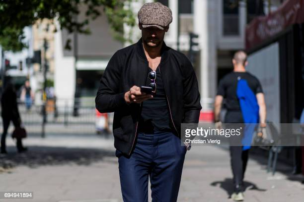 David Gandy wearing a flat cap during the London Fashion Week Men's June 2017 collections on June 11 2017 in London England