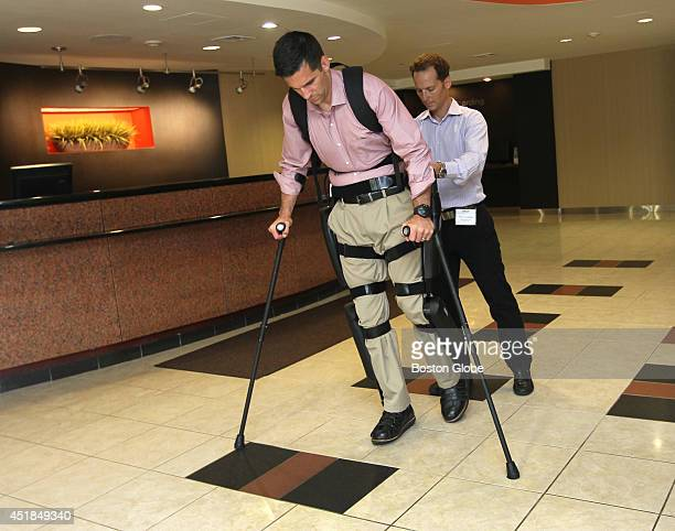 David Garber Senior Clinical Trainer helps Derek Herrera a paraplegic US Marine demonstrate ReWalk an exoskeleton using motors and braces for upright...