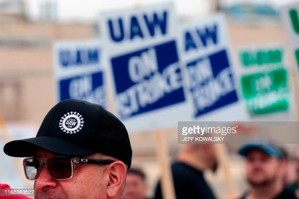 David Garcia a United Auto Workers member who is employed at the General Motors Co Flint Assembly plant in Flint Michigan pickets outside of the...