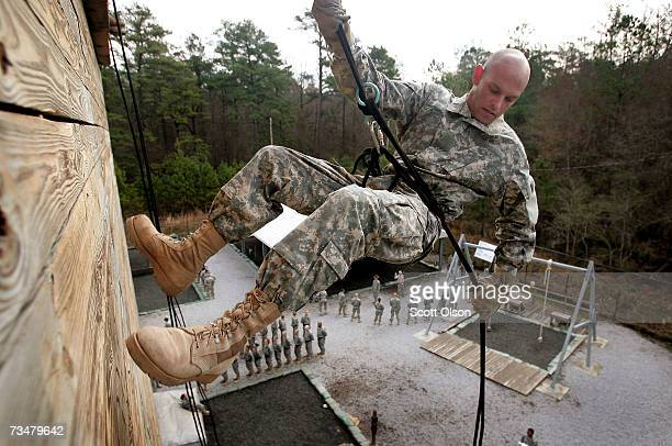 David Gardner of Peeble Ohio rappels down a wall during Army basic training at Fort Jackson March 2 2007 in Columbia South Carolina In 2006 the Army...