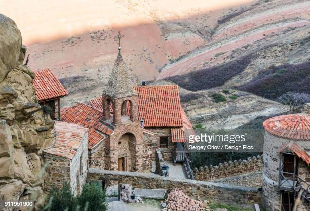 david gareja monastery complex (the 6th century rock-hewn georgian orthodox monastery with hundreds of cave cells, churches, chapels, refectories and living quarters) - 6th century bc stock photos and pictures