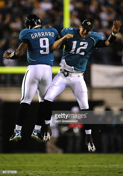 David Garrard and Luke McCown of the Jacksonville Jaguars celebrate after Jacksonville scored a touchdown in the first half against the Indianapolis...