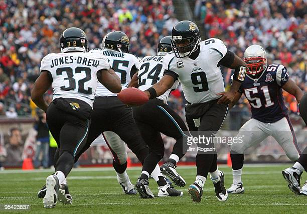 David Garrard of the Jacksonville Jaguars hands the ball to team mate Maurice JonesDrew against the New England Patriots at Gillette Stadium on...