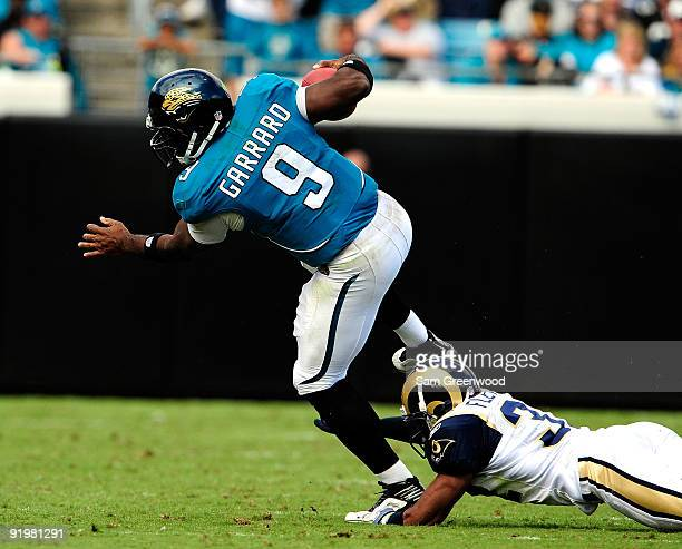 David Garrard of the Jacksonville Jaguars is tackled by Bradley Fletcher of the St Louis Rams during the game at Jacksonville Municipal Stadium on...