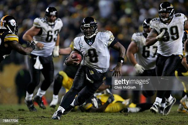 David Garrard of the Jacksonville Jaguars runs for a 32yard gain against the Pittsburgh Steelers to set up the gamewinning field goal during the...