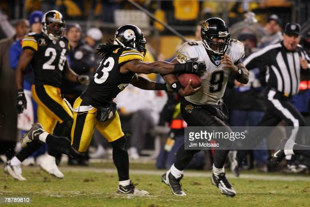 David Garrard of the Jacksonville Jaguars runs out of the grasp of Tyrone Carter of the Pittsburgh Steelers to set up the gamewinning field goal...