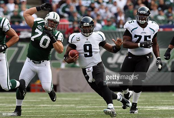 David Garrard of the Jacksonville Jaguars runs the ball against the New York Jets on November 15 2009 at Giants Stadium in East Rutherford New Jersey