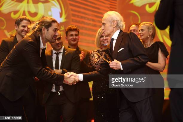 David Garrett and Jose Carreras during the 25th annual Jose Carreras Gala final applause on December 12 2019 at Messe Leipzig in Leipzig Germany
