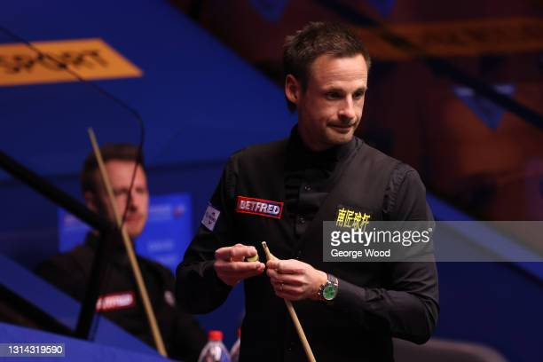 David Gilbert of England chalks the cue during the Betfred World Snooker Championship Round Two match between David Gilbert of England and Judd Trump...