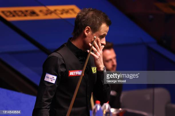 David Gilbert of England reacts during the Betfred World Snooker Championship Round Two match between David Gilbert of England and Judd Trump of...