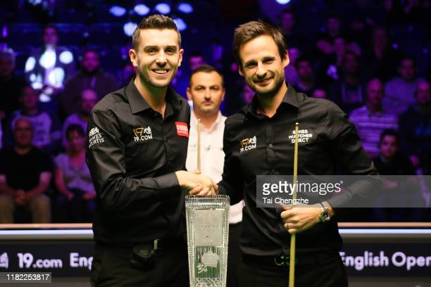 David Gilbert of England shakes hands with Mark Selby of England prior to their final match on day seven of 2019 English Open at K2 Leisure Centre on...