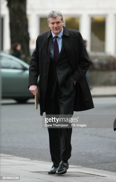 David Gill chief executive of Manchester United arrives at Manchester Civil Justice Centre for a court case where Wayne Rooney and his wife Coleen...