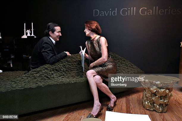 David Gill of London UK left speaks to Anne Kaplan of Chicago Illinois while sitting on a FredriksonStallard couch in Gill's Gallery booth during the...